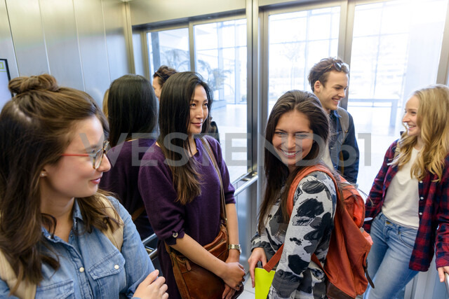 University students talking inside elevator - CUF47431