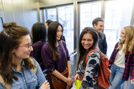 University students talking inside elevator - CUF47431