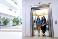 University students exiting elevator in campus - CUF47434
