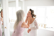 Bride and mother on morning of wedding day - CUF47455
