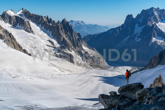 Hiker enjoying scenery, Chamonix-Mont-Blanc, Rhone-Alpes, France - CUF47485