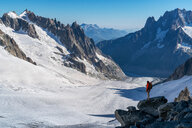 Hiker enjoying scenery, Chamonix-Mont-Blanc, Rhone-Alpes, France - CUF47485