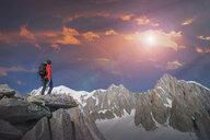 Hiker enjoying scenery, Chamonix-Mont-Blanc, Rhone-Alpes, France - CUF47488