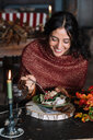 Young woman eating fresh salad at vintage table - CUF47566
