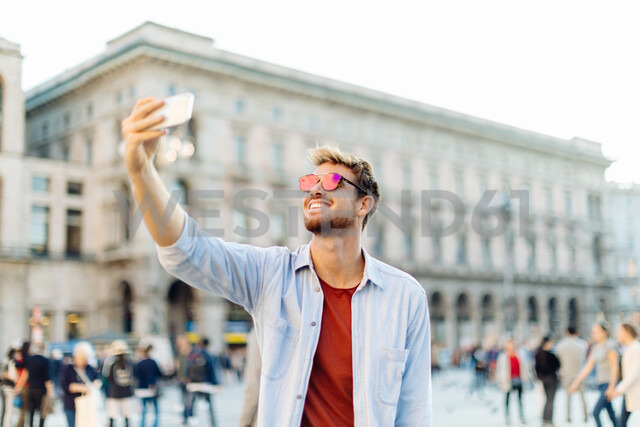 Man taking selfie, Piazza del Duomo, Milan, Italy - CUF47623