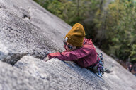 Rock climber gripping onto cracks, Malamute, Squamish, Canada - CUF47659