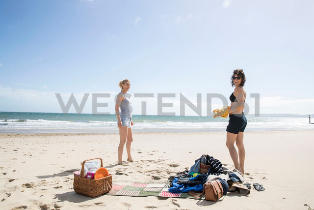 Sisters enjoying themselves on beach - CUF47716