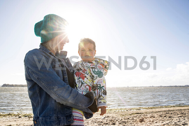 Mother and toddler girl on beach - CUF47734