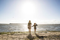 Mother and daughter on beach - CUF47737