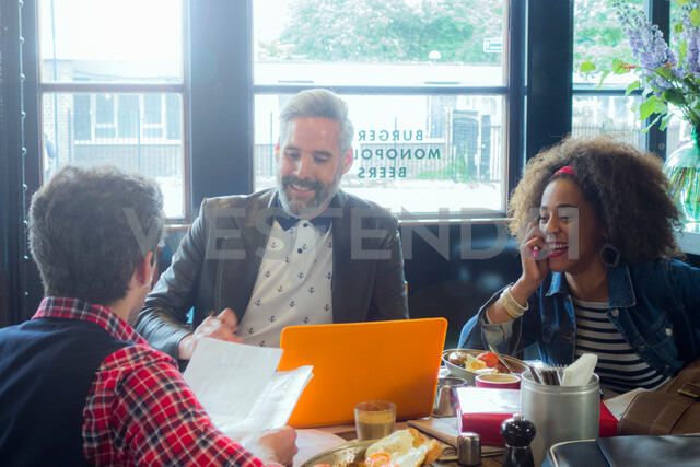 Friends at breakfast meeting in cafe, London, UK - CUF47749