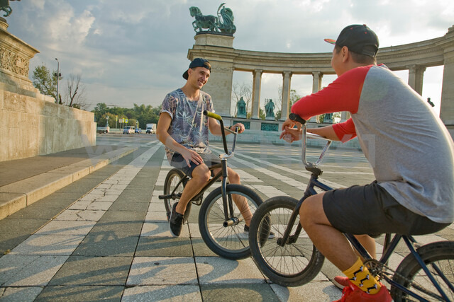 BMX cyclist resting, Heroes' Square (Hosök Tere), Budapest, Hungary - CUF47794