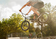 BMX cyclist doing stunt on ramp - CUF47797