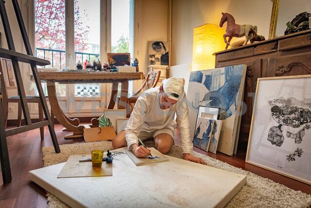 Artist working on canvas in studio - CUF47809
