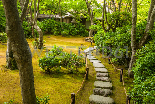 Stone path in Okochi Sanso, the former home and garden of the Japanpanese jidaigeki or period film actor Denjiro Okochi, located in Arashiyama, Kyoto, Japan - ASTF02133