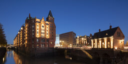 Germany, Hamburg, Speicherstadt, old warehouseand Fleetschloesschen at dusk - WIF03743