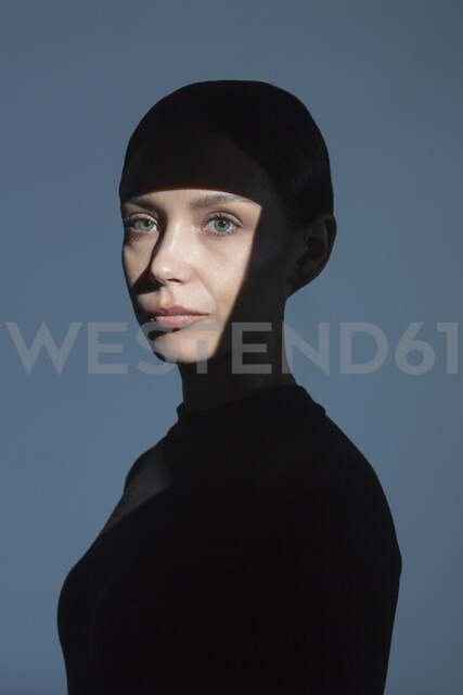 Portrait of woman with shadow and light on her face - VGF00184