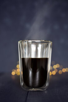 Glass of steaming black coffee - JESF00202