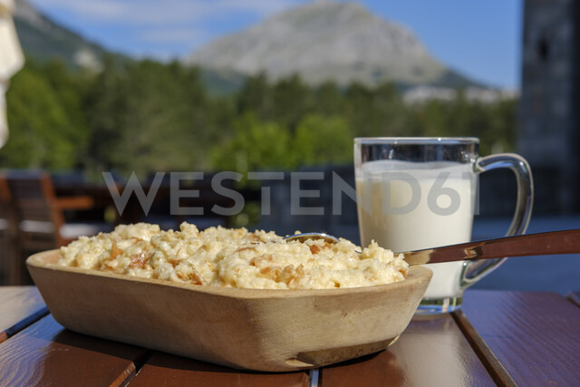 Montenegro, Popara with milk on wooden table - SIEF08317