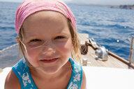 Cute girl on boat wearing headscarf, portrait, Castellammare del Golfo, Sicily, Italy - CUF47907