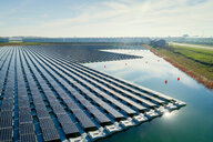 Floating solar panels installed on water supply of neighbouring greenhouses, elevated view, Netherlands - CUF47943