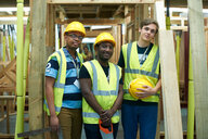 Three male higher education carpentry students in college workshop, portrait - CUF48012
