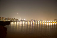 Illumination of Banpo Bridge reflected in water, Han River, Seoul, South Korea - CUF48027