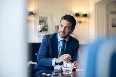 Businessman having coffee in office - CUF48060