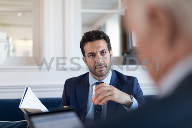 Businessmen talking in restaurant - CUF48069