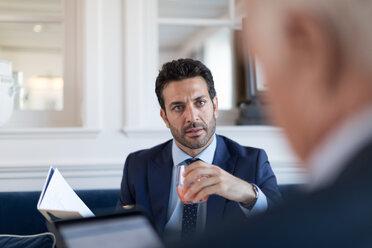 Businessmen talking in restaurant - CUF48069