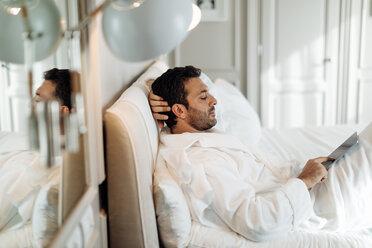 Man using digital tablet in suite - CUF48078