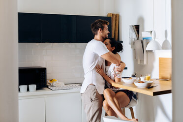 Young couple hugging in kitchen - CUF48105