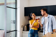 Young couple toasting in kitchen - CUF48117