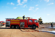 Firemen and fire engine in training centre, Darlington, UK - CUF48141