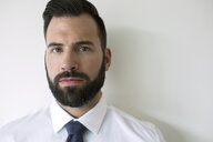 Close up portrait serious brunette businessman with beard - HEROF05230
