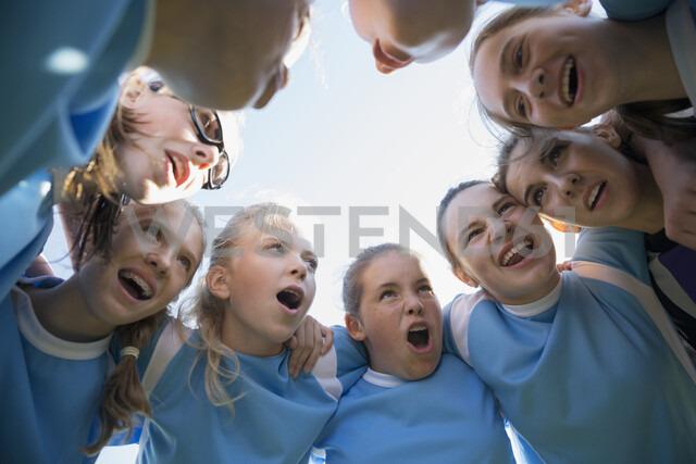 Determined middle school girl soccer team in huddle - HEROF05254