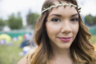 Close up portrait young woman wearing leaf headband - HEROF05296