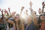 Enthusiastic crowd cheering at summer music festival - HEROF05329