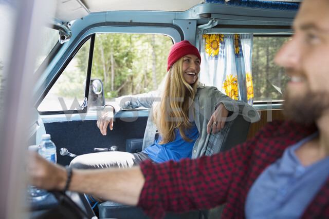 Couple driving and riding in camper van - HEROF05389