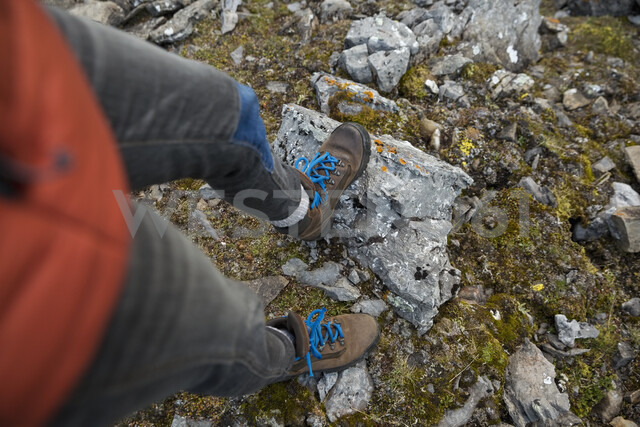 Directly above female hiker wearing hiking boots with blue shoelaces - HEROF05395
