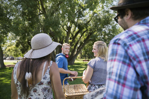 Couples with picnic basket in summer park - HEROF05422