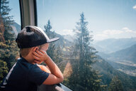 Boy contemplating view of valley, Bludenz, Vorarlberg, Austria - CUF48206