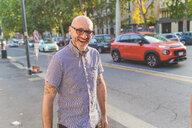 Happy mature man on city street, portrait - CUF48239