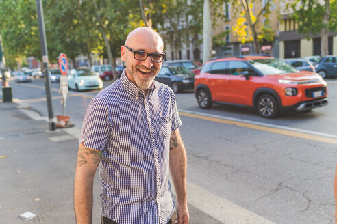 Happy mature man on city street, portrait - CUF48239