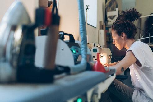 Fashion designer working at sewing machine - CUF48269