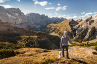 Hiker and pet dog enjoying view, Karwendel region, Hinterriss, Tirol, Austria - CUF48314