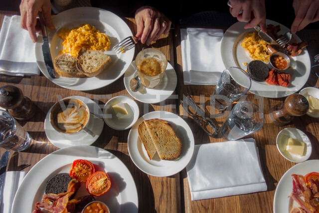 Breakfast for four outdoors on sunny day - CUF48371