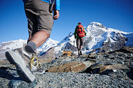 Hiker friends in Mont Cervin, Matterhorn, Valais, Switzerland - CUF48431