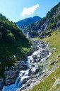 Hiker crossing narrow bridge, Mont Cervin, Matterhorn, Valais, Switzerland - CUF48440
