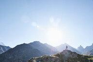 Hiker on peak of rock, Mont Cervin, Matterhorn, Valais, Switzerland - CUF48443