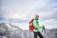 Portrait of hiker in cold conditions, Mont Cervin, Matterhorn, Valais, Switzerland - CUF48449